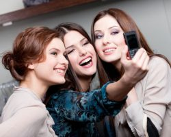 Three Pretty Girls Taking a Photo | Cosmetic Dentistry in West Liberty, IA and Muscatine, IA | Gentle Family Dentists