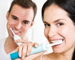 Man and Woman Brushing Their Teeth Together | Dental Prevention in West Liberty, IA and Muscatine, IA | Gentle Family Dentists