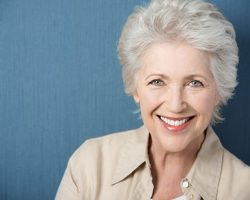 Confident Old Woman Brightly Smiling | Dental Crowns and Bridges in West Liberty, IA and Muscatine, IA | Gentle Family Dentists
