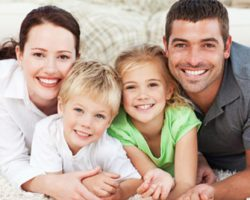 Gleeful Family of Four | Full-Mouth Reconstruction in West Liberty, IA and Muscatine, IA | Gentle Family Dentists
