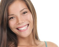 Woman Smiling to Show Her Teeth and Gums | Gum Disease Treatment in West Liberty, IA and Muscatine, IA | Gentle Family Dentists