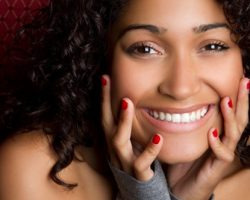 Confident Young Lady Beaming | Gum Reshaping in West Liberty, IA and Muscatine, IA | Gentle Family Dentists