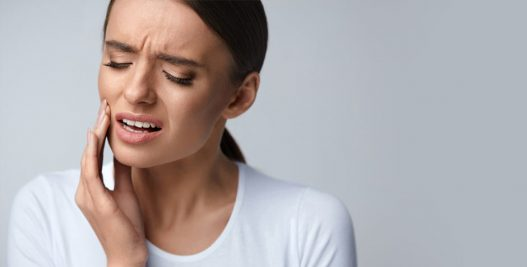 Lady pained with her toothache | Restorative Dental Treatments: Chewing Difficulty Solution in West Liberty, IA and Muscatine, IA | Gentle Family Dentists