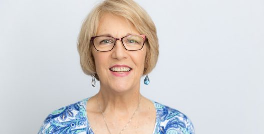 Mature Looking Woman with Eyeglasses Smiling | Dental Implants in West Liberty, IA | Gentle Family Dentists
