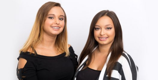 Healthy-looking women with traditonal braces | Orthodontics Treatment Options in Muscatine, IA | Gentle Family Dentists