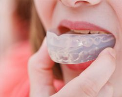 Woman Wearing a Clear-Colored Mouthguard | West Liberty, IA and Muscatine, IA | Gentle Family Dentists