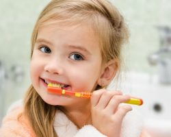 Cute Girl Brushing Her Teeth | Pediatric Dentistry in West Liberty, IA and Muscatine, IA | Gentle Family Dentists