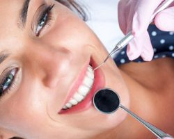 Young Lady Smiling While Having Her Dental Examination | Preventative Orthodontics Adults in West Liberty, IA and Muscatine, IA | Gentle Family Dentists