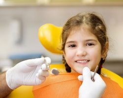 Smiling Little Girl During Her Dental Examination | Preventative Orthodontics Kids in West Liberty, IA and Muscatine, IA | Gentle Family Dentists
