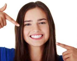 Young Lady Showing Her Beautiful Teeth | Root Canal Treatment in West Liberty, IA and Muscatine, IA | Gentle Family Dentists