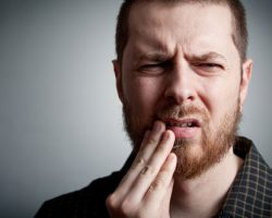 Guy suffering from toothache | West Liberty, IA and Muscatine, IA | Gentle Family Dentists