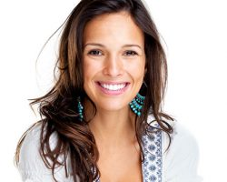 Woman Smiling Brightly | West Liberty, IA and Muscatine, IA | Gentle Family Dentists