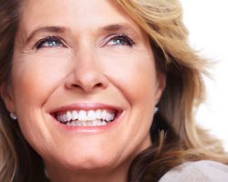 Old Woman showing a fulfilling smile | West Liberty, IA and Muscatine, IA | Gentle Family Dentists